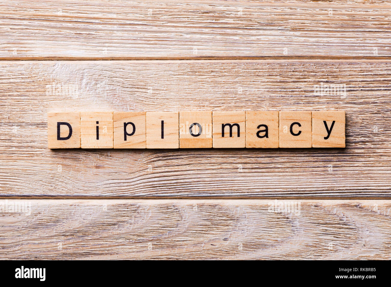 diplomacy word written on wood block. diplomacy text on wooden table for your desing, concept. - Stock Image