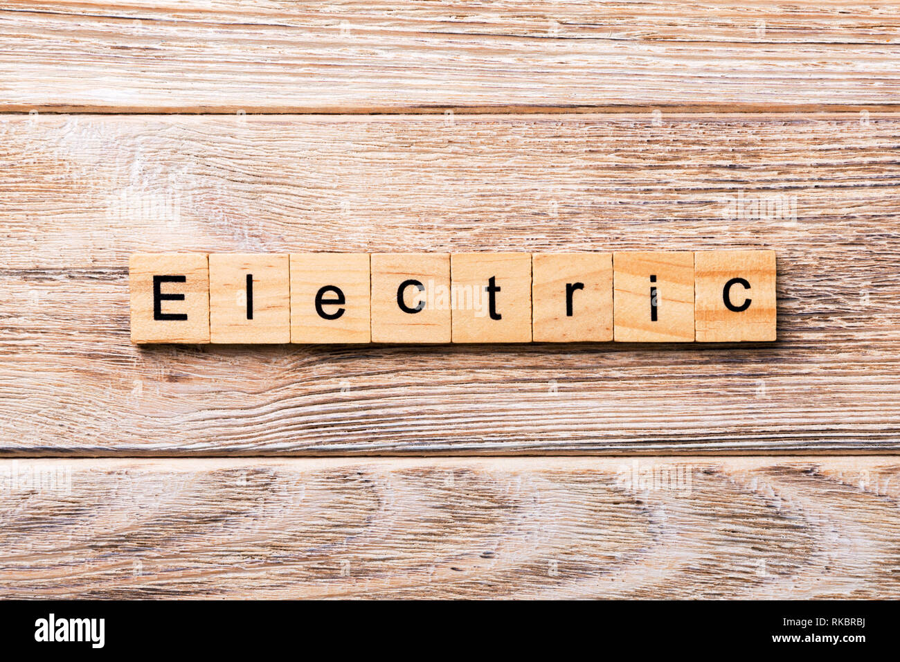 Electric word written on wood block. Electric text on wooden table for your desing, concept. Stock Photo
