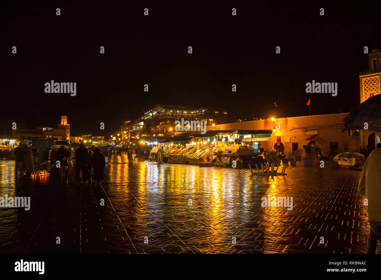 Famous Jemaa el Fna square crowded at dusk. Marrakesh, Morocco Stock Photo
