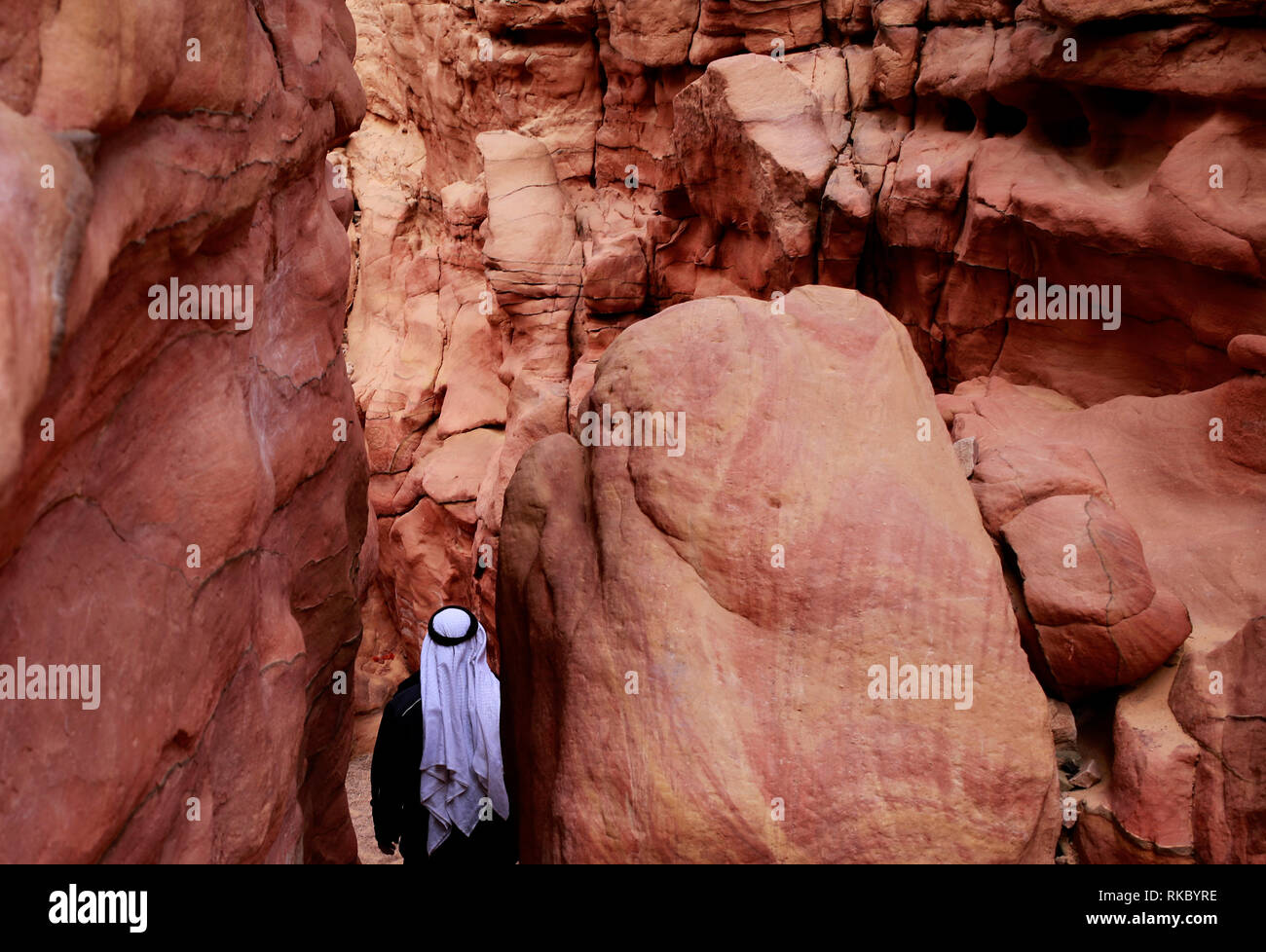 A Bedouin man walks through Egypt's Coloured Canyon near Nuweiba in the Sinai Peninsula.(Photo/Hasan Jamali) - Stock Image