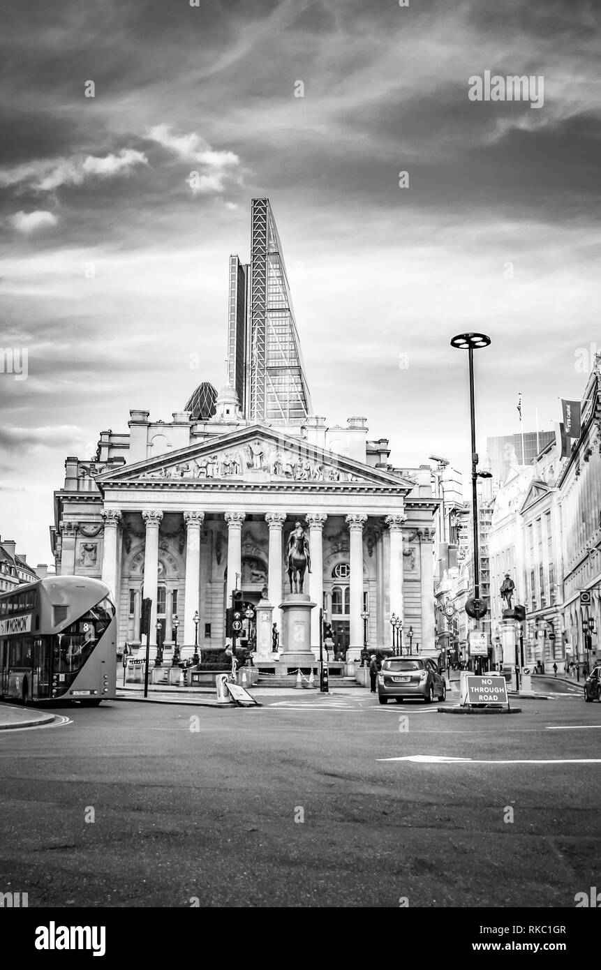 London, Great Britain - August 1, 2015: Black and white photo from the traffic at a street corner in the bank district of London. - Stock Image