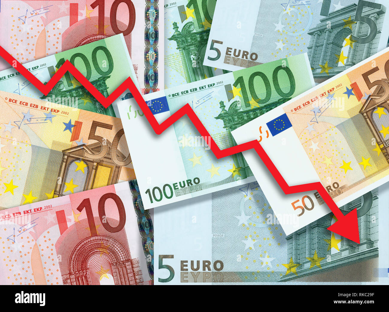 Euro money fall concept, arrow chart pointing down against background made of Euro bills - Stock Image