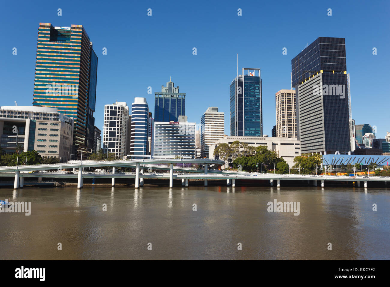 Modern skyline and elevated highway of Brisbane, Australia across the water on a sunny day - Stock Image