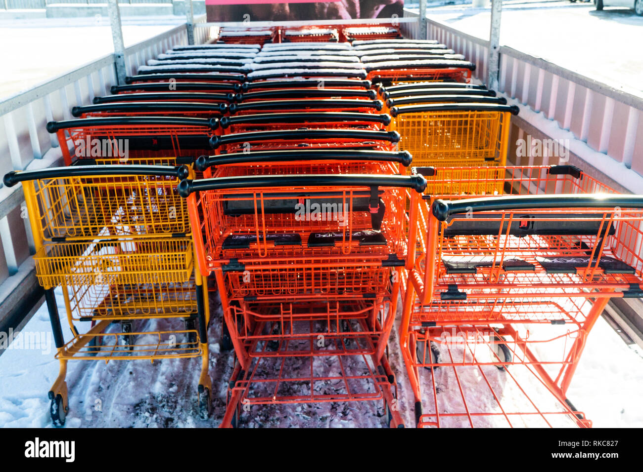 Supermarket mall shopping cart outside in snow - Stock Image