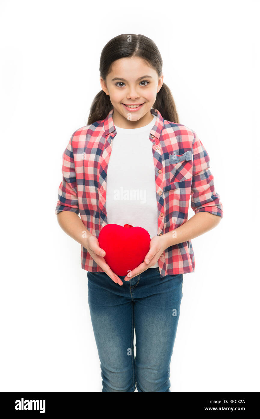 Greeting from sincere heart. Girl cute child hold heart symbol love. Celebrate valentines day. Love and romantic feelings concept. Red heart attribute of valentine. Heart gift or present. Me to you. - Stock Image