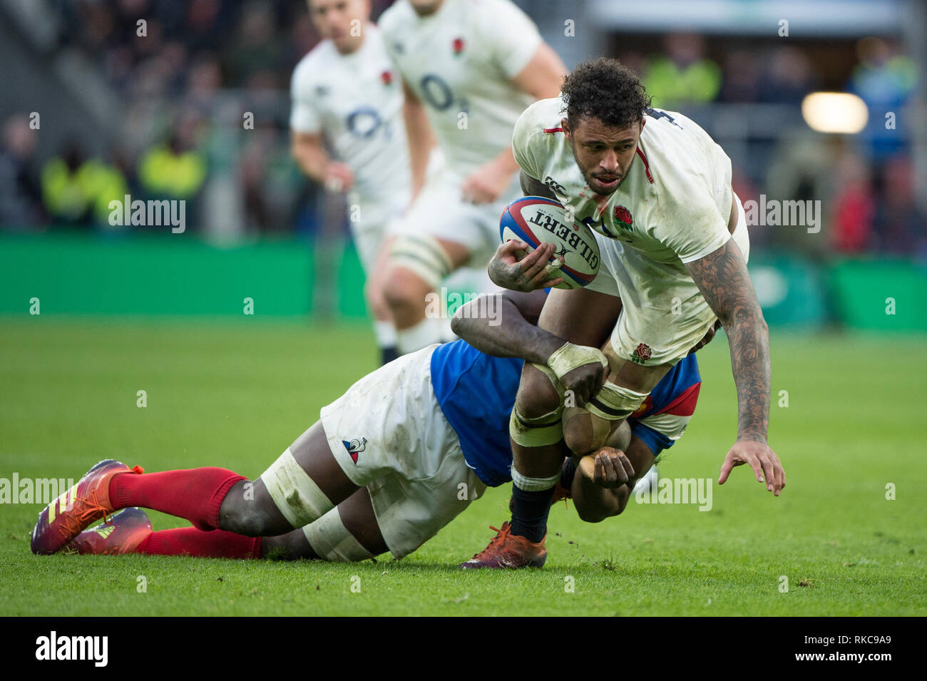 Twickenham, United Kingdom. 7th February, Courtnt Lawes tackled by Yacouba CAMERA, during the England vs France, 2019 Guinness Six Nations Rugby Match   played at  the  RFU Stadium, Twickenham, England,  © PeterSPURRIER: Intersport Images Credit: Peter SPURRIER/Alamy Live News Stock Photo