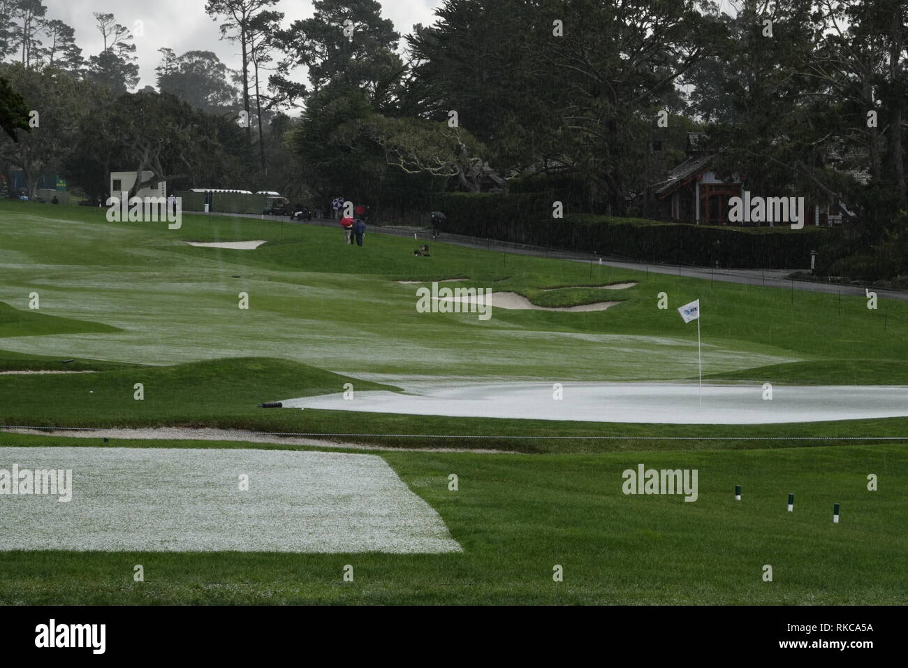Pebble Beach Golf Links, California, USA. 10th Feb 2019.   Hail stops play during the final round at Pebble Beach Golf Course at  the AT&T Pro-Am at Pebble Beach (here the 15th hole looks like a ski slope) Credit: Motofoto/Alamy Live News Stock Photo