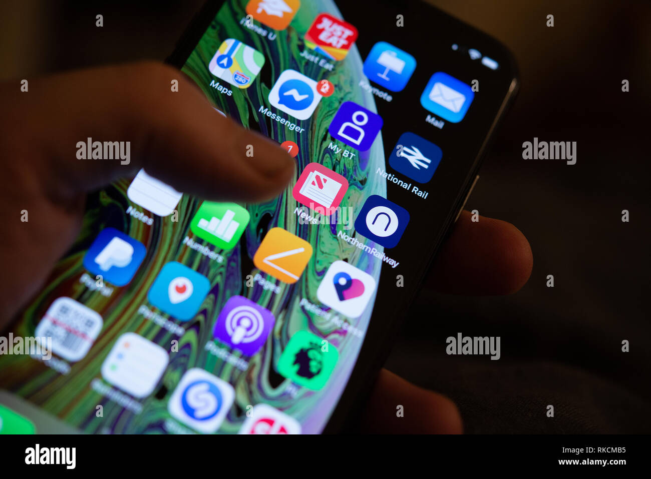 A person holds an iPhone XS mobile phone in Stockport, United Kingdom on Monday, February 11, 2019. Apple have asked app developers to guarantee that people's privacy, in regard to mobile phone usage, on mobile phones or face removal from their App Store according to a report on The Independent website. Credit: Jonathan Nicholson/Alamy Live News - Stock Image