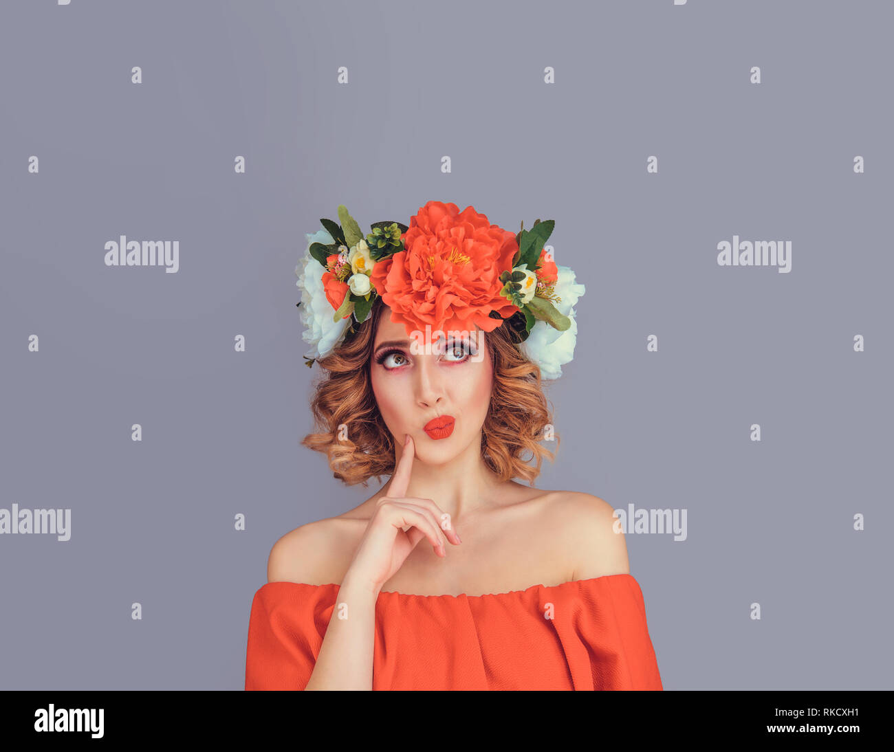 skeptical woman wearing peony floral headband - Stock Image