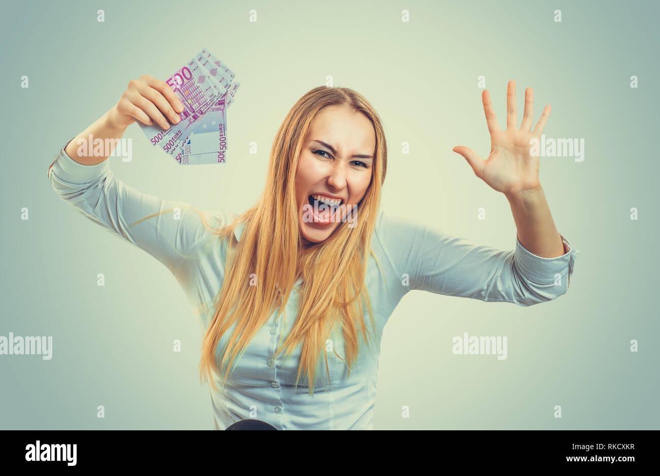 Woman happy holding money.  - Stock Image