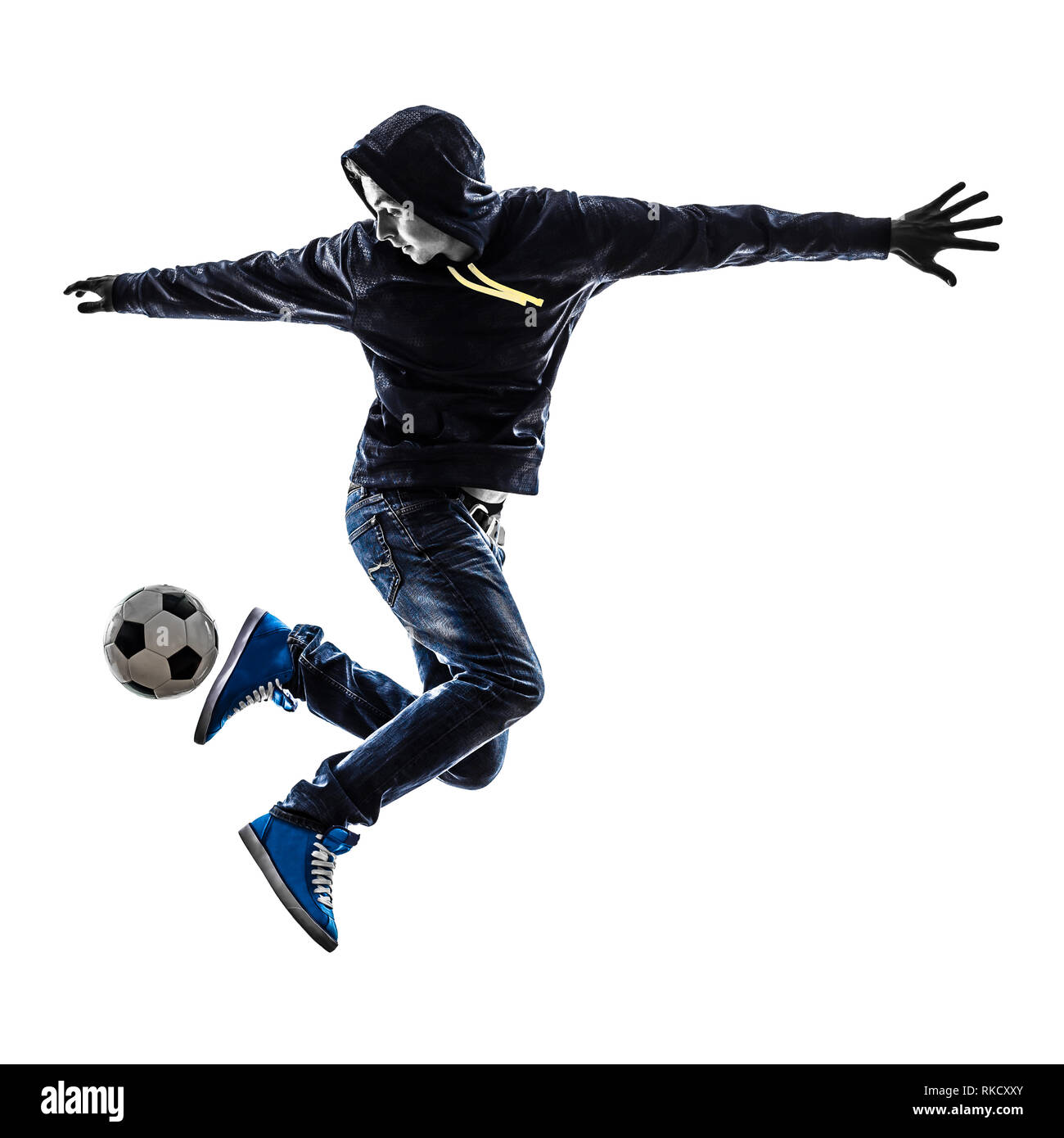 one  young man soccer freestyler player in silhouette on white background - Stock Image