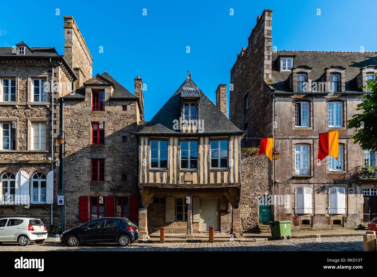 Dinan, France - July 23, 2018: Picturesque old houses in historic centre of the city. Stock Photo