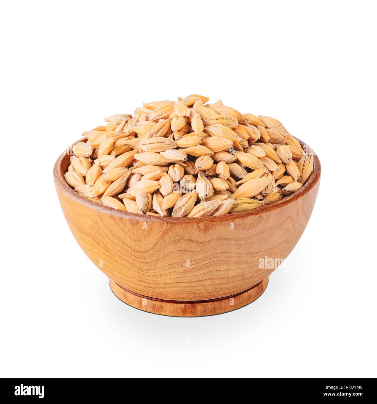 Bowl of barley seeds isolated on white background Stock Photo