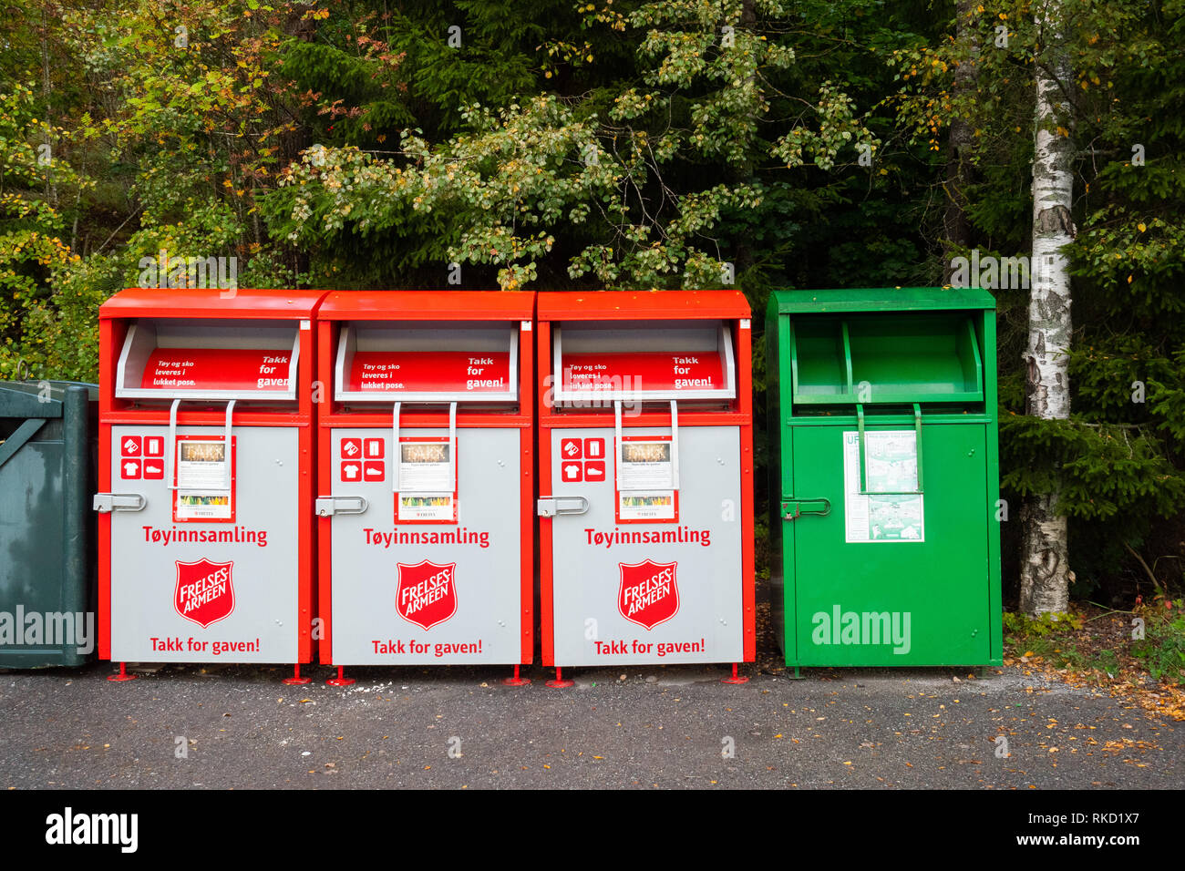 Four recycling bins for second hand clothes in Norway - Stock Image