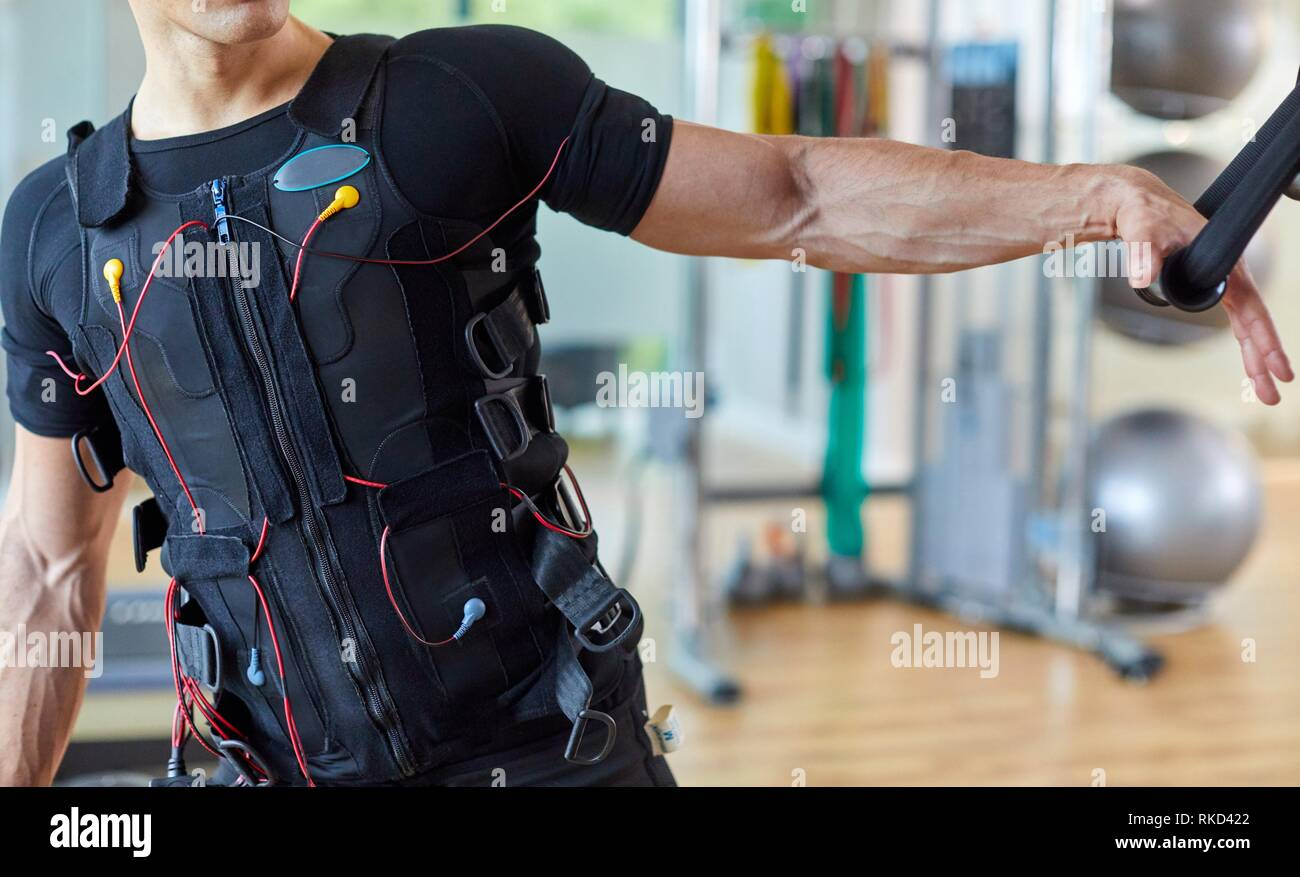 Training, Exercise with vest with electrostimulation, Fitness center, Donostia, San Sebastian, Basque Country, Spain, Europe Stock Photo
