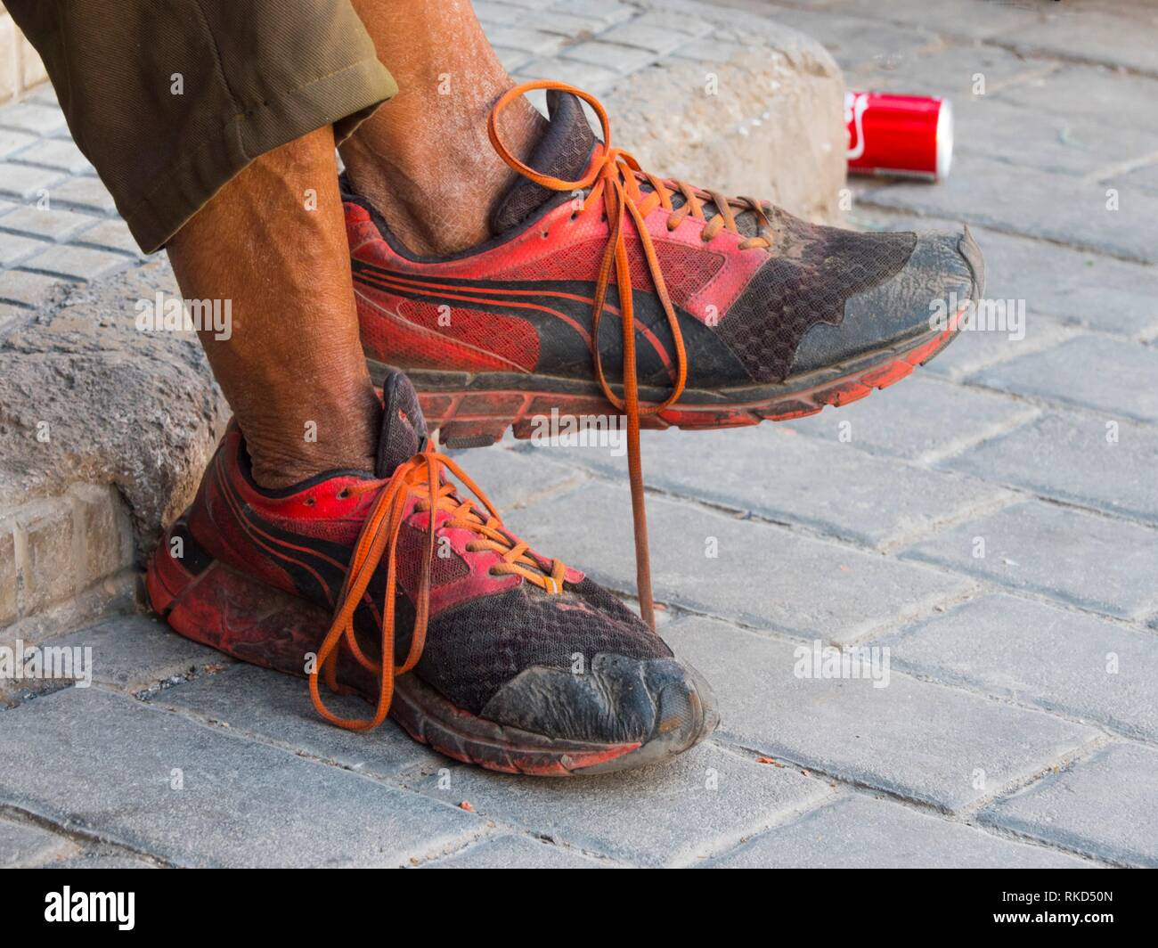 Poverty concept: legs of a homeless man. France - Stock Image