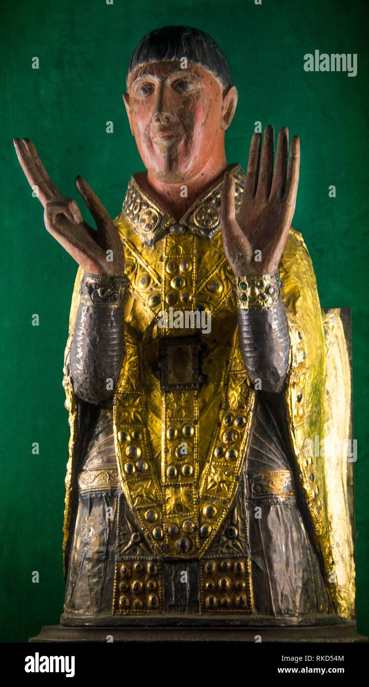 France, Auvergne,Cantal, 12th Century figure of Saint Cesaire (polichromat wood, gold and silver) at the parish church of Maurs. - Stock Image