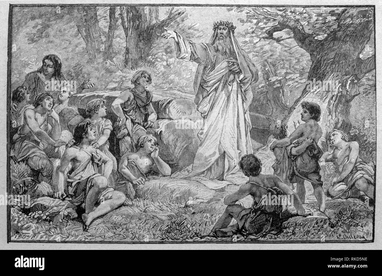 France. Druid lecturing in a forest. A druid was a member of the high-ranking professional class in ancient Celtic cultures. While perhaps best - Stock Image