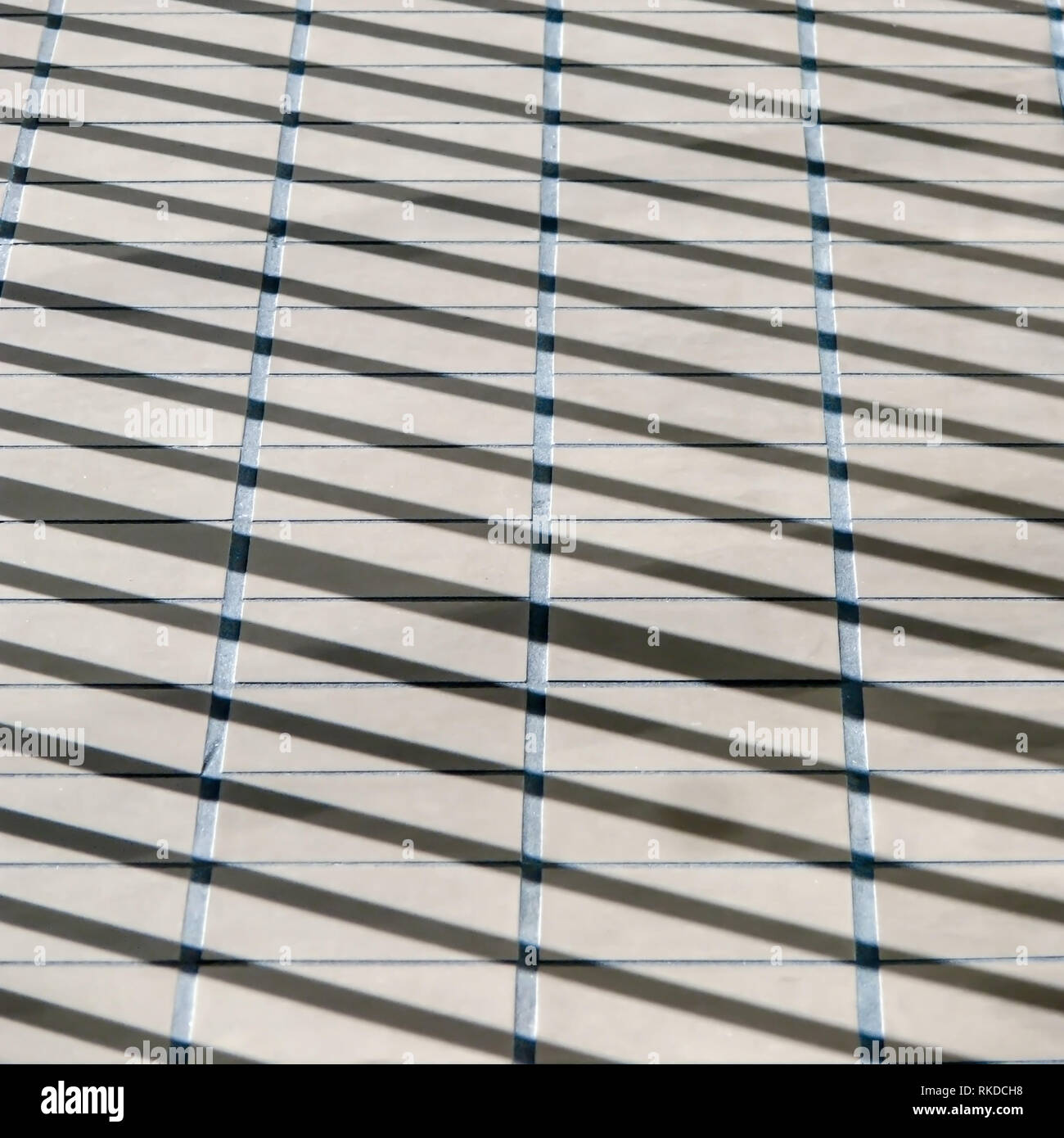 Shadow pattern on a sidewalk abstract background. - Stock Image