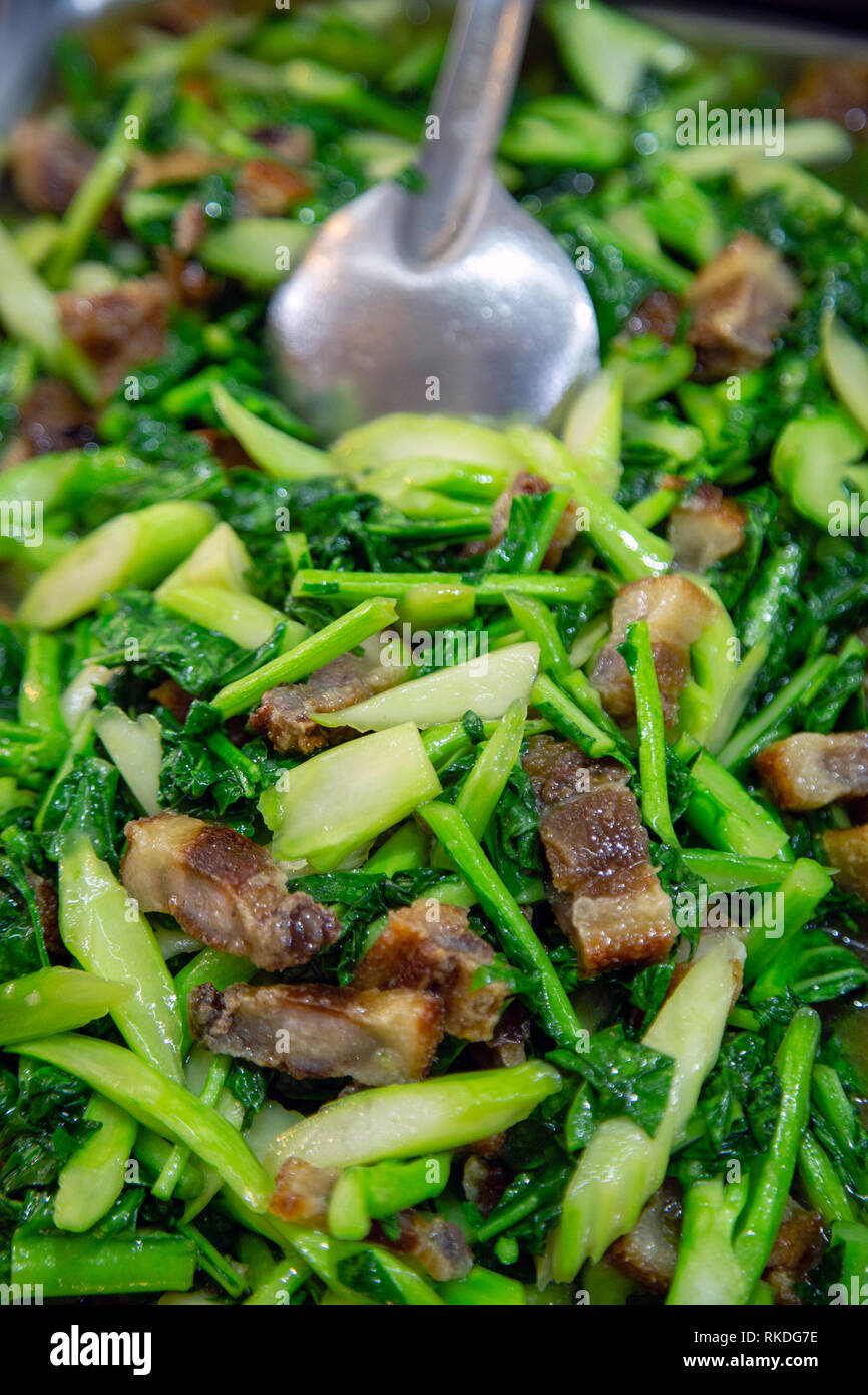 Pad pak kana moo krob literally translates to fried kale crispy pork
