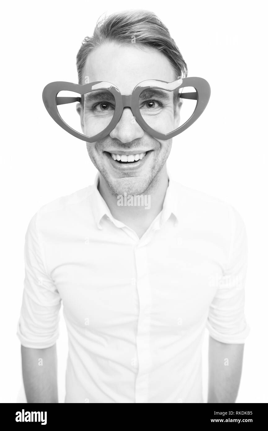 Funky and happy. Man happy smiling in valentines glasses. Handsome man wear heart shape glasses. Party goer. Happy valentines day party. Its party time. - Stock Image