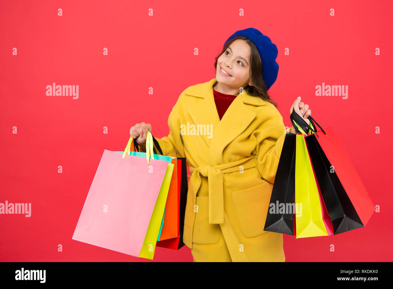 Prime time buy spring clothing. Obsessed with shopping. Girl cute kid hold shopping bags. Get discount shopping on birthday holiday. Nice purchase. Fashionista enjoy shopping. Customer satisfaction. - Stock Image