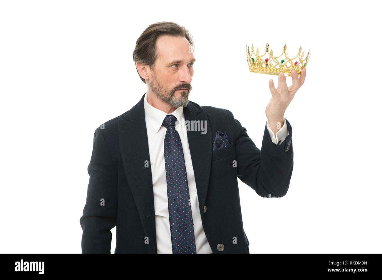 Direct line to throne. Enormous privilege. Become king ceremony. King attribute. Become next king. Monarchy family traditions. Man nature bearded guy in suit hold golden crown symbol of monarchy. - Stock Image