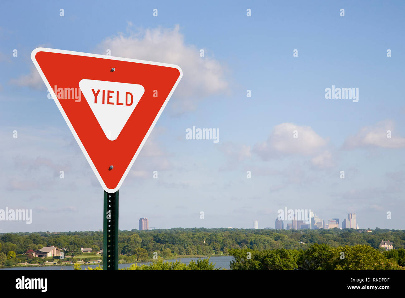 Yield Sign And City Skyline - Stock Image