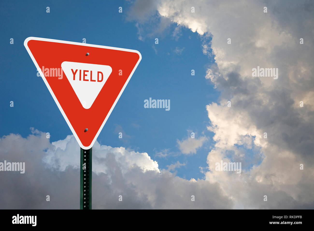 Yield Sign With Clouds - Stock Image