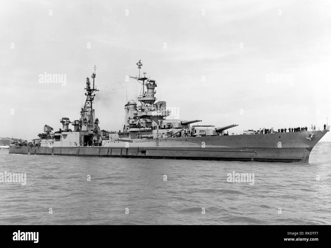 The U.S. Navy heavy cruiser USS Indianapolis (CA-35) off the Mare Island Naval Shipyard, California (USA), on 10 July 1945, after her final overhaul and repair of combat damage. The photo was taken before the ship delivered atomic bomb components to Tinian and just 20 days before she was sunk by a Japanese submarine. - Stock Image
