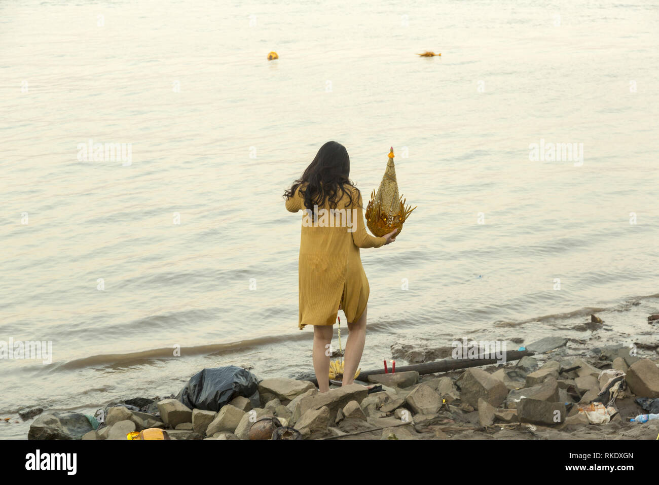 Prayer at the river bank in Phnom Penh, Cambodia - Stock Image