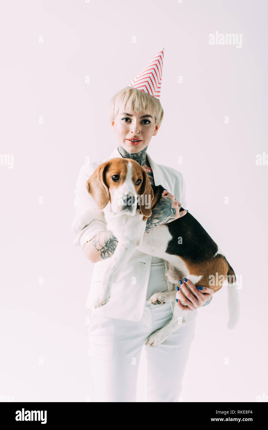 Blonde Woman With Tattoos Holding In Arms Cute Beagle Dog Isolated On Grey Stock Photo Alamy