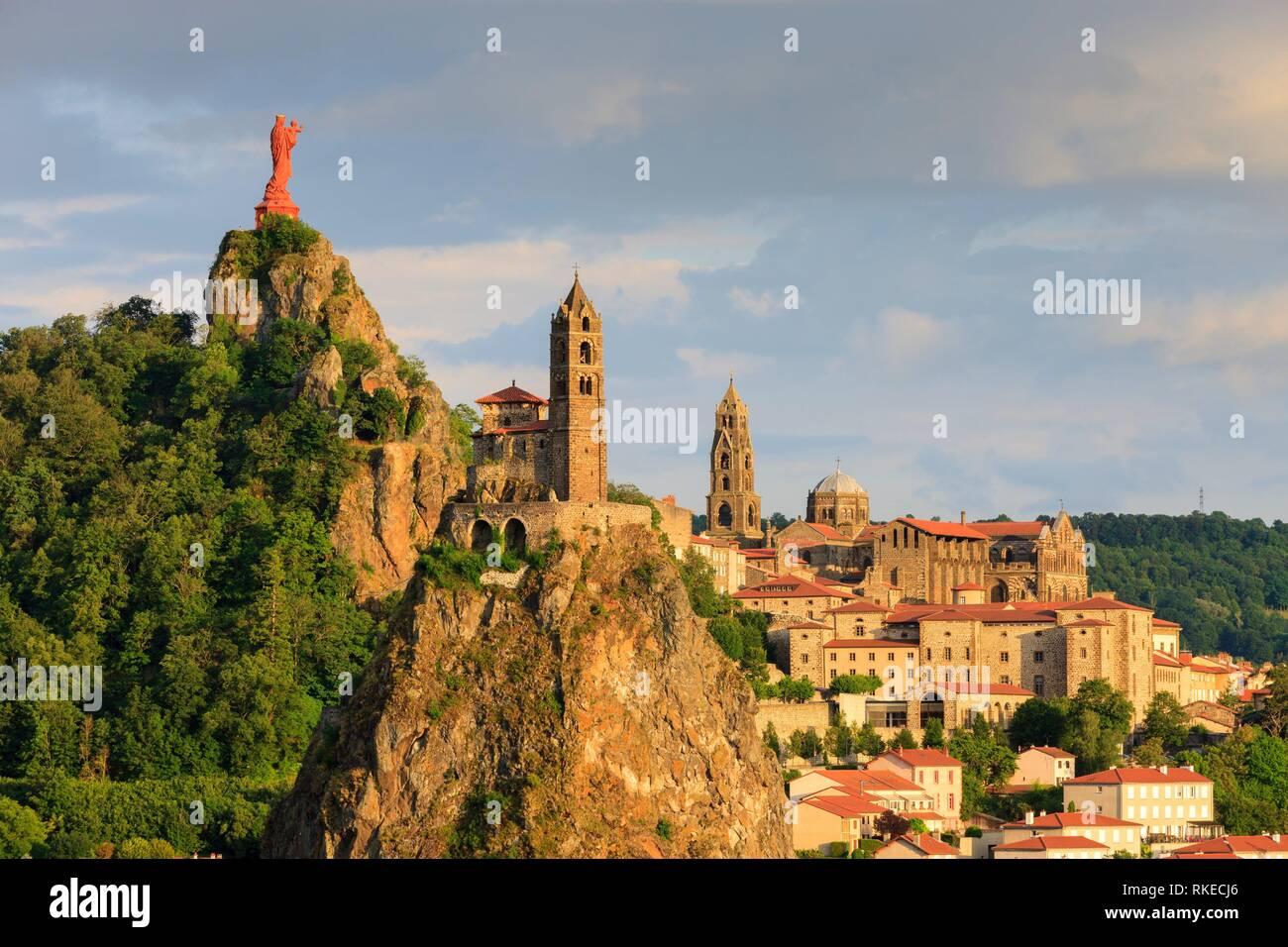 Statue of Notre Dame de France with Saint Michel d'Aiguilhe Chapel and Notre Dame Cathedral Le Puy en Velay Haute-Loire Auvergne-Rhône-Alpes France. Stock Photo