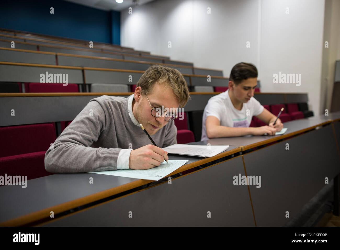 Man sitting supervised Mensa IQ test at University College London, ENGLAND, UK - Stock Image