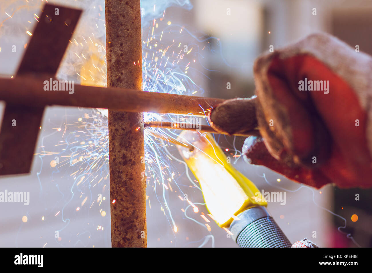 Welding machine close-up of a spark when working with welding - Stock Image