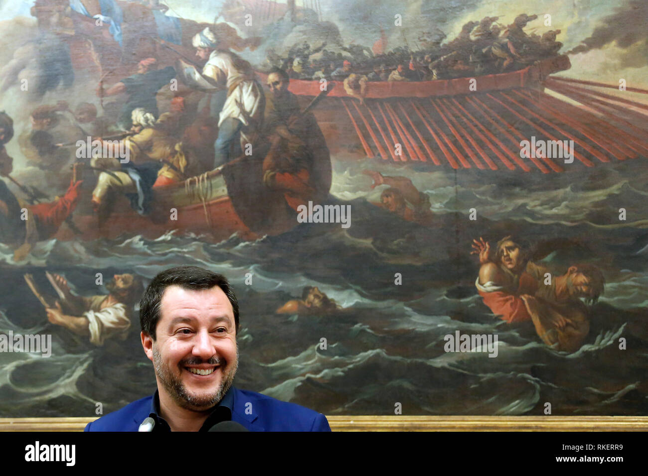 Roma, Italy. 11th Feb, 2019. Matteo Salvini and on his shoulders the painting 'Lepanto battle', with boats and shipwrecked, fought on October 7th 1571 during the Cipro's War, between the Ottomans and the Christians Navy Rome February 11th 2019. Sala Salvadori. The Italyn Minister of Internal Affairs in press conference after the outcome of regional elections in Abruzzo. Foto Samantha Zucchi Insidefoto Credit: insidefoto srl/Alamy Live News Stock Photo