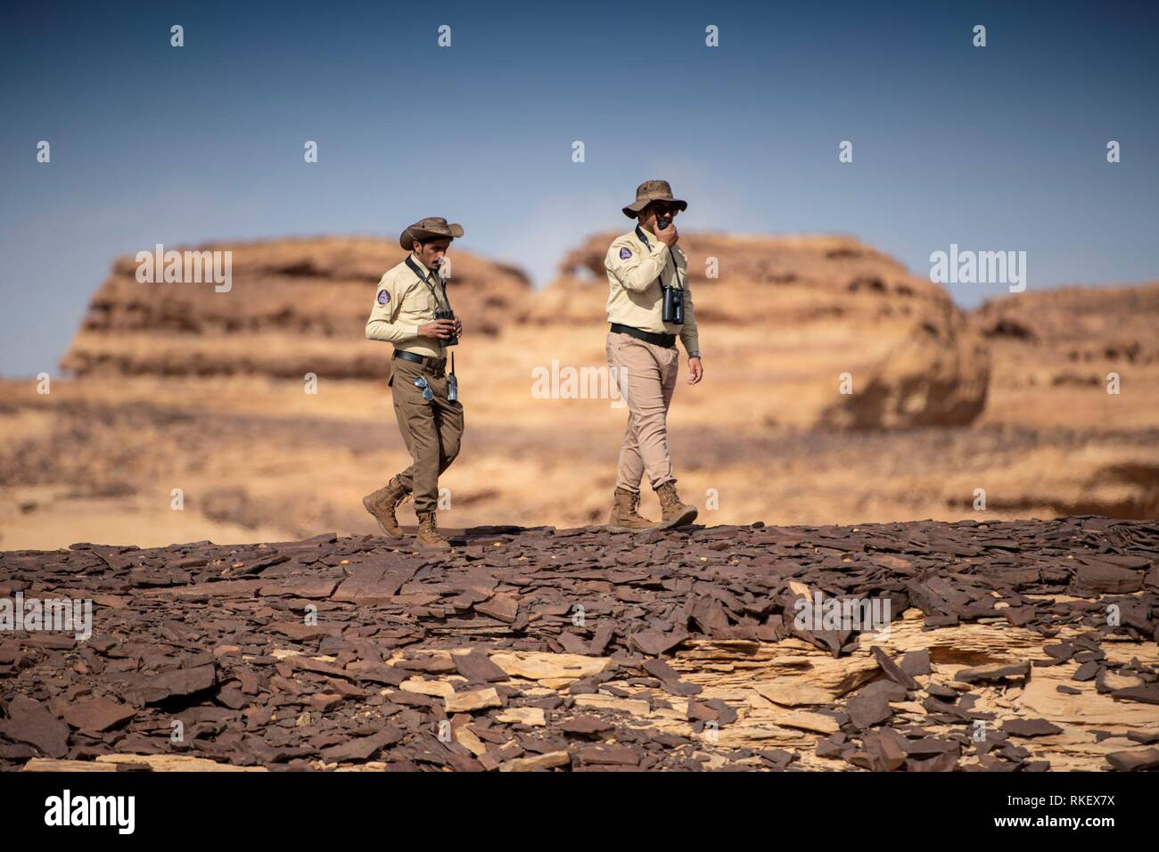 Al Ula. 11th Feb, 2019. Staff members walk in the Sharaan Nature Reserve in Al-Ula, Saudi Arabia, Feb. 10, 2019. Saudi Arabia's Crown Prince Mohammed bin Salman launched on Sunday a set of development and conservation projects in the historic site of Al-Ula, in an attempt to turn the attraction into a worldwide cultural destination. Credit: The Royal Commission for Al-Ula/Xinhua/Alamy Live News - Stock Image