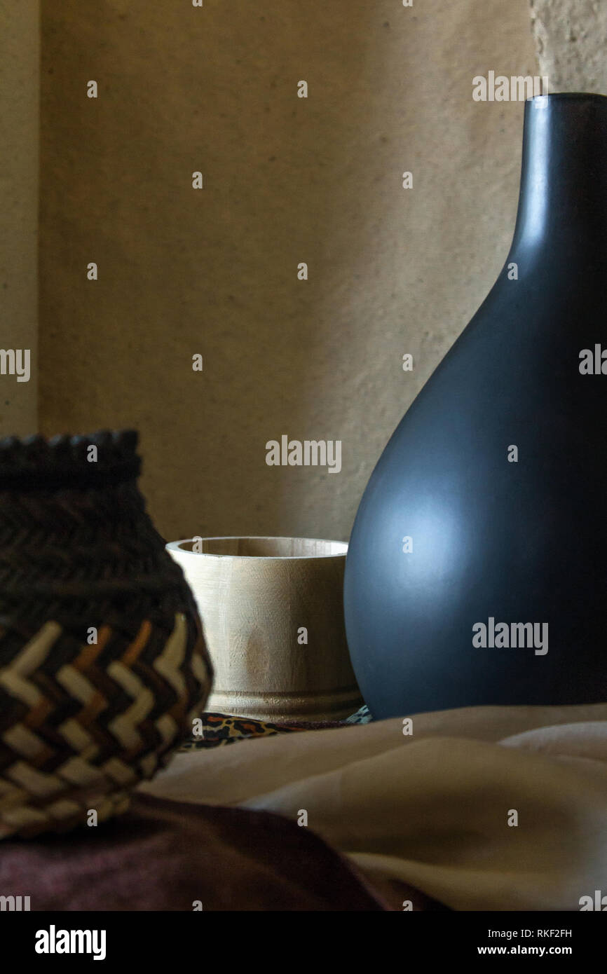 Earthy coloured still life photograph with archaic wooden and ceramic objects Stock Photo