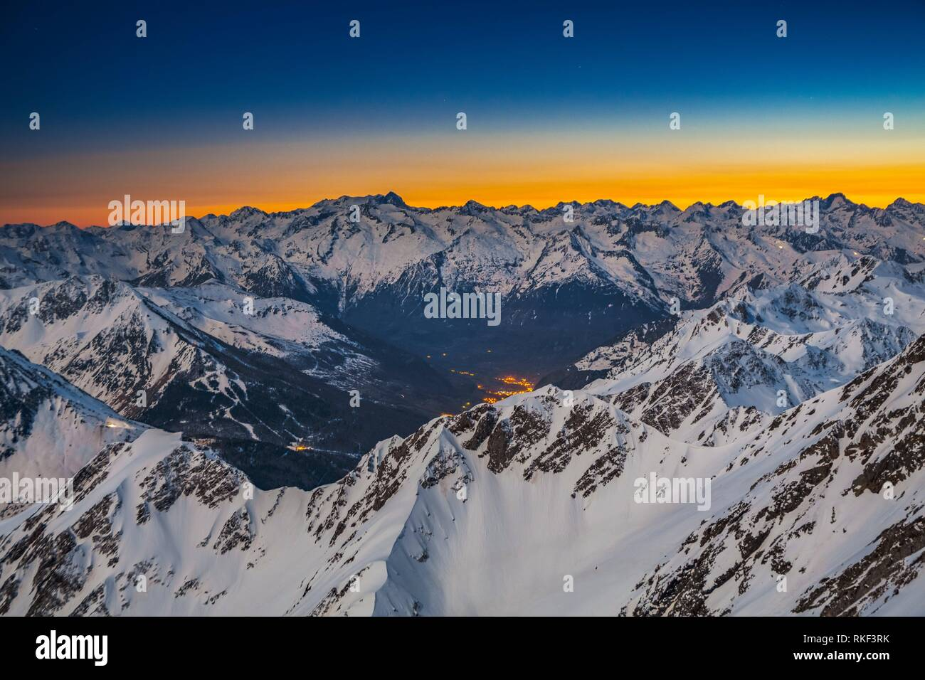 Sunset and view from Pic du Midi de Bigorre. On the left Vignemale mountain. On the right Balaitus mountain or Pic du Balaitous. Grand Tourmalet ski - Stock Image