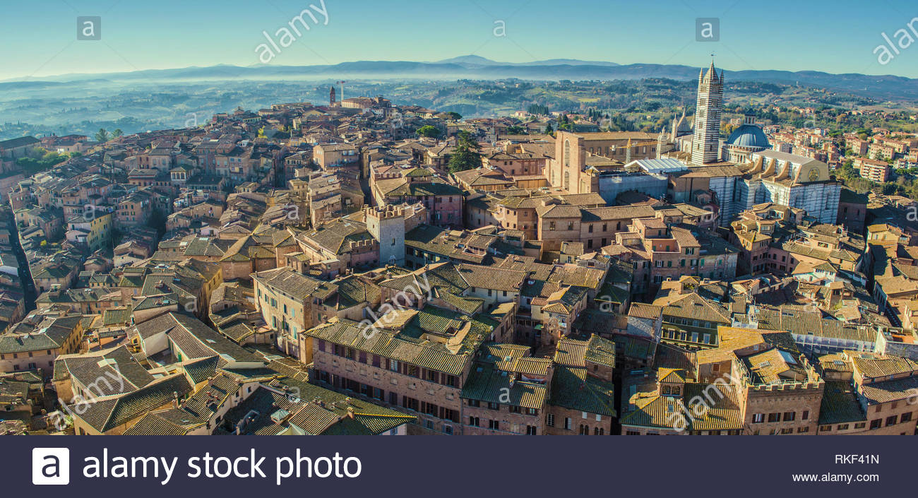 Panoramic bird eye view of Siena, Italy, taken from Torre del Mangia (highest tower in Siena). The dominant building on the right is Siena Cathderal. - Stock Image