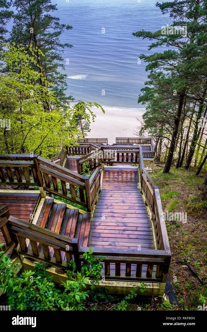 View from the top of wooden stairs on Baltic Sea beach in Miedzyzdroje seaside resort on Wolin Island in West Pomeranian Voivodeship of Poland. - Stock Image
