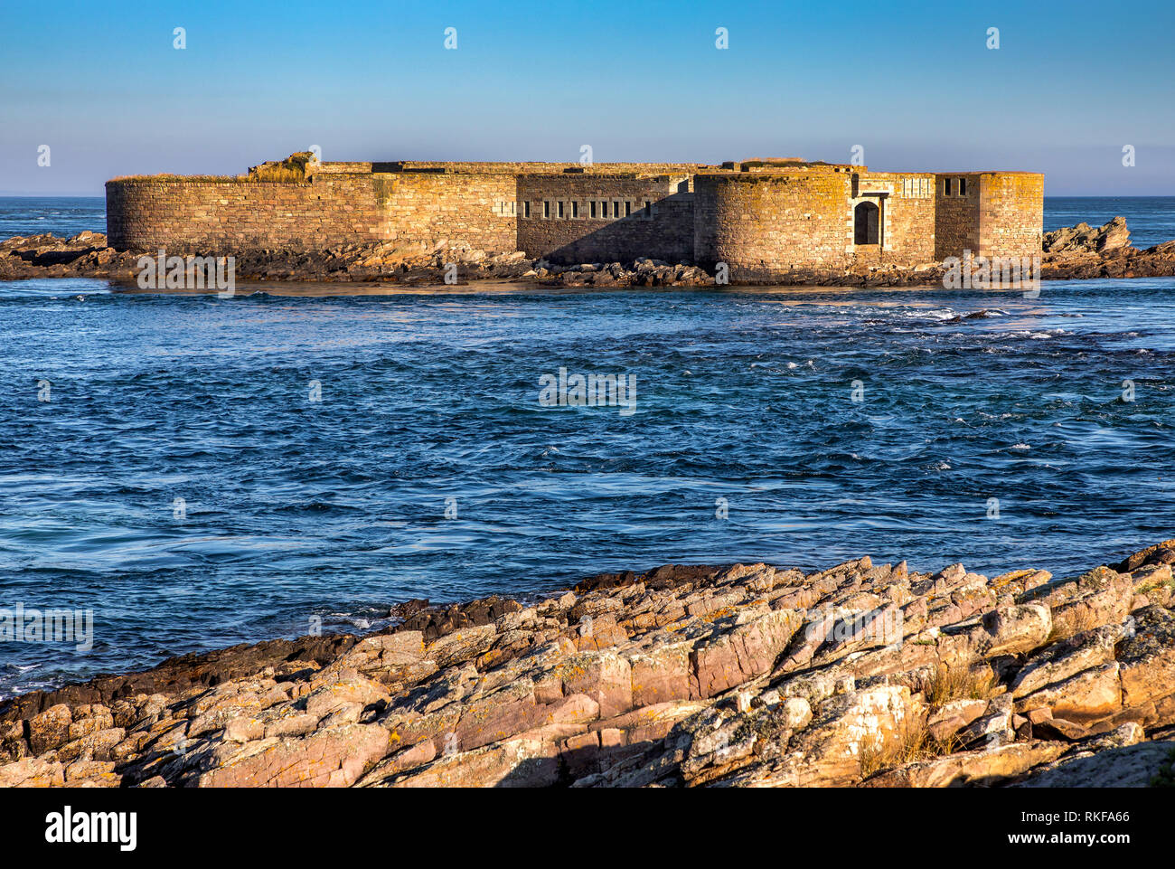 View of Fort Houmet Herbe' from La Petite Folie on the Alderney mainland. - Stock Image