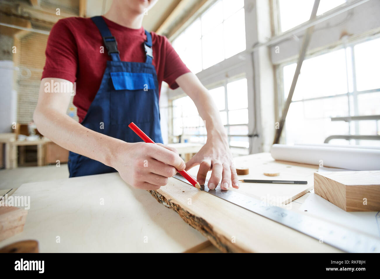 Making marks on wooden plank Stock Photo