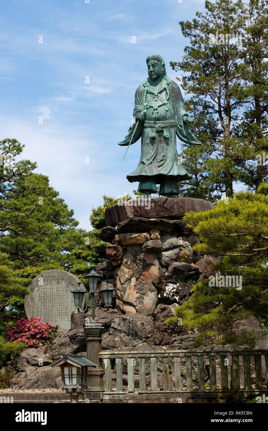 Statue of prince Yamato Takeru, a Japanese mythological hero, in Gyokuseninmaru Garden at Kanasawa castle. - Stock Image