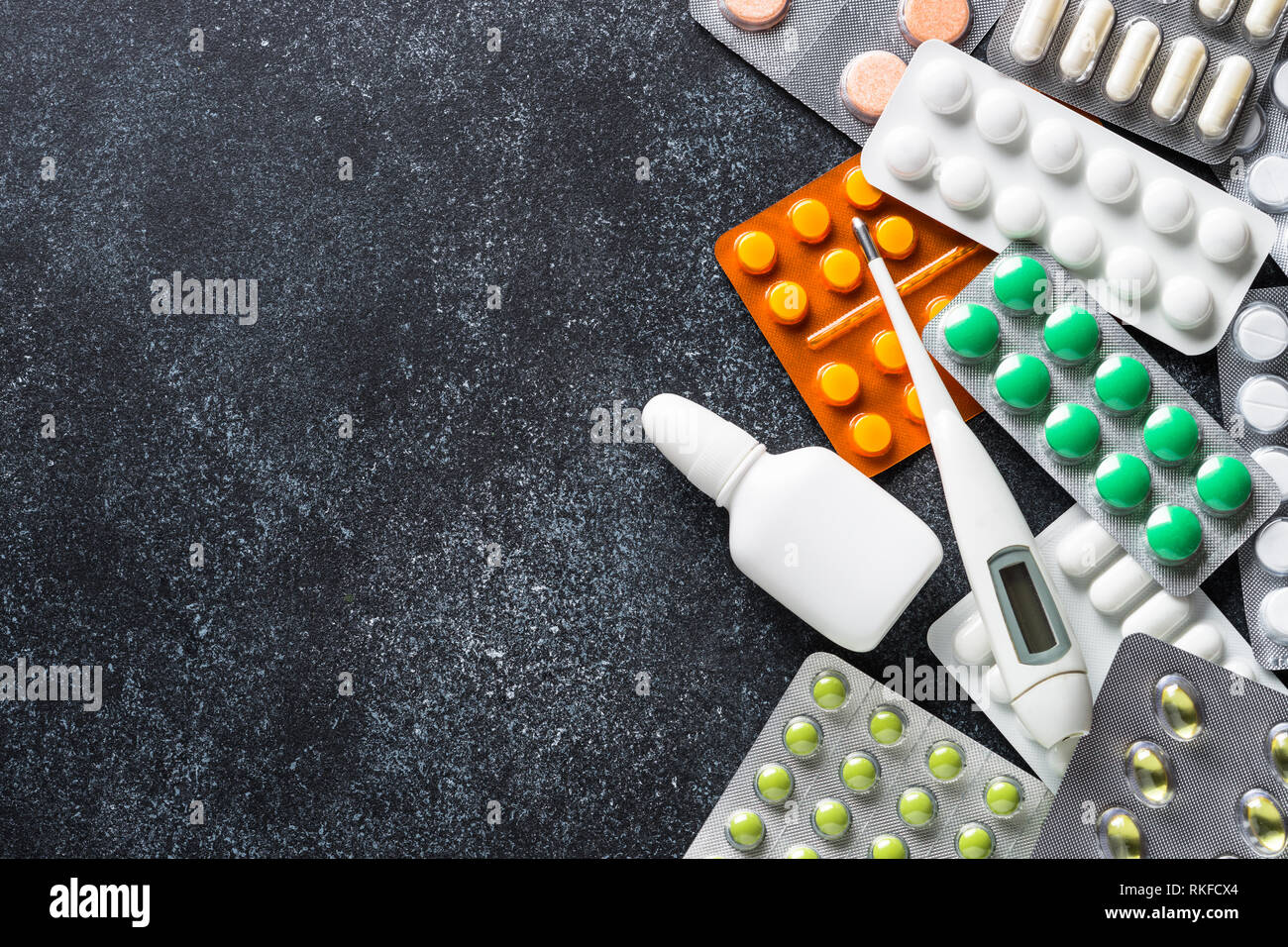 Tablets and medicines on a black top view Stock Photo: 235752668 - Alamy