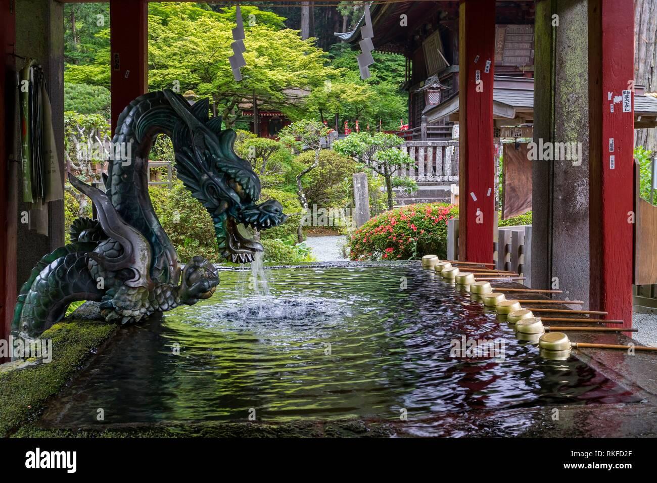 Purification basin with a water dragon at Fujiyoshida Sengen Shrine in Fujiyoshida city. - Stock Image