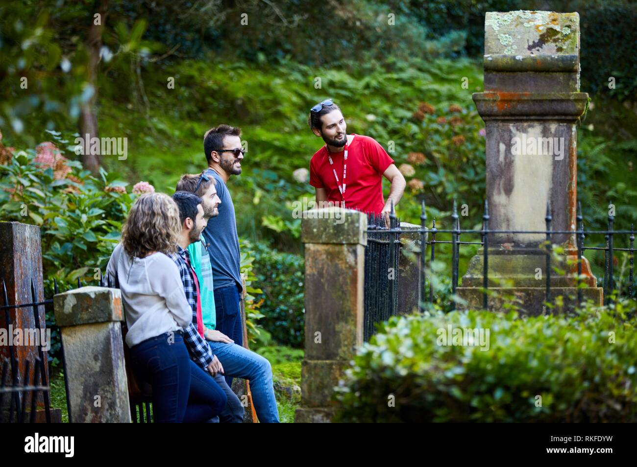 Group of tourists and guide making a tour of the city, Climb to Mount Urgull, Cemetery of the English, Donostia, San Sebastian, Gipuzkoa, Basque - Stock Image