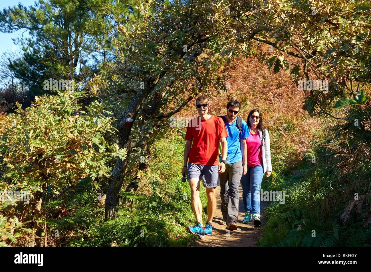 Group of tourists and guide making a tour of the Camino de Santiago, St. james Way, Pasaia, Donostia, San Sebastian, Gipuzkoa, Basque Country, Spain, - Stock Image
