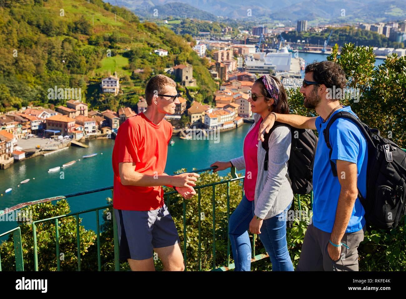 Group of tourists and guide making a tour of the Camino de Santiago, St. james Way, Pasai Donibane, Pasajes de San Juan, Gipuzkoa, Basque Country, - Stock Image