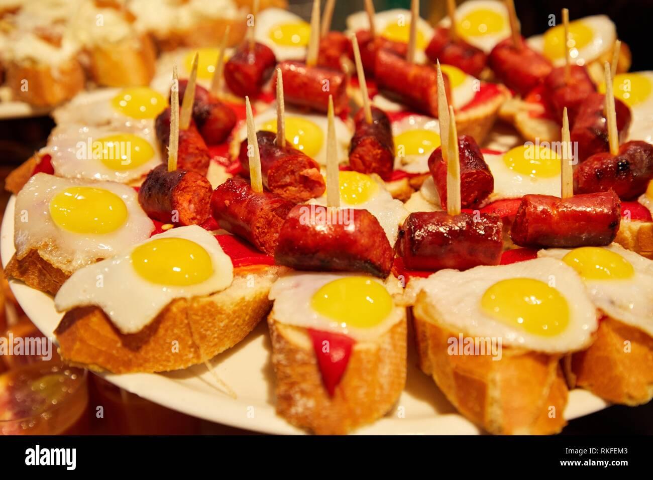 Quail egg and fried chistorra, Pintxos, Bar Taberna Aralar, Parte Vieja, Old Town, Donostia, San Sebastian, Gipuzkoa, Basque Country, Spain - Stock Image